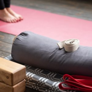 Caucasian females legs on yoga mat with yoga props